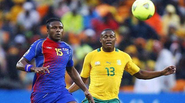 Cape Verde's Soares challenges South Africa's Dikgacoi during the opening match of the Africa Cup of Nations tournament in Soweto