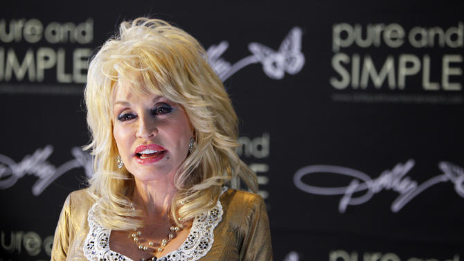 Dolly Parton attends a press conference prior to her concert at the Ryman Auditorium on Friday, July 31, 2015, in Nashville, Tenn. (Photo by Wade Payne/Invision/AP)