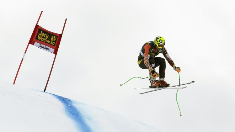 Canada's Osborne-Paradis clears a gate during the second training session of the Men's World Cup Downhill skiing race in Val Gardena