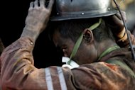File photo shows a rescuer at the site of a mining accident in China in 2011. Ten miners have been killed in an accident in a coal mine in northwest China, state media said Saturday, a week after an explosion killed 45 miners in another part of the country