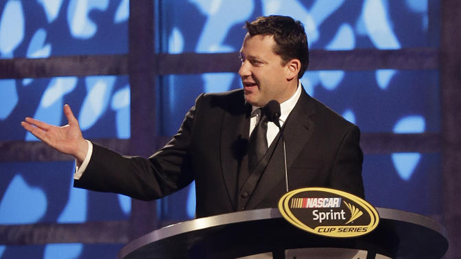 Tony Stewart speaks during the season-ending NASCAR awards ceremony while accepting the award for his 9th place finish in the NASCAR Sprint Cup Series Championship, Friday, Nov. 30, 2012, in Las Vegas. (AP Photo/Julie Jacobson)