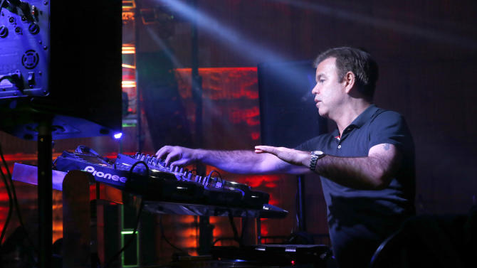 Paul Oakenfold performs at the 16th Annual Friends 'N' Family Pre-Grammy Party at Paramount Studios on Friday, Feb. 8, 2013 in Los Angeles. (Photo by Todd Williamson/Invision/AP)