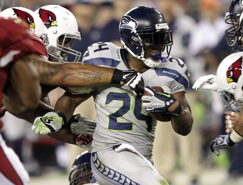 Seattle Seahawks running back Marshawn Lynch (24) runs against the Arizona Cardinals during the first half of an NFL football game, Thursday, Oct. 17, 2013, in Glendale, Ariz. (AP Photo/Rick Scuteri)