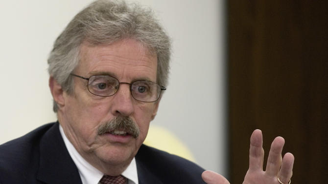 FILE - J. Davitt McAteer, the state's lead investigator into the Sago coal mine disaster, takes questions at a West Virginia Coal Mine Safety Board meeting in Charleston, W.Va., in this Aug. 16, 2006 file photo. Federal documents filed by a NASA fraud investigator indicate a former head of the Mine Safety and Health Administration and the Catholic college in West Virginia where he works conspired for six years to misuse millions of grant dollars from the space agency for personal gain and the school's benefit. The allegations are contained in an affidavit that an agent in the NASA Office of Inspector General used to obtain search warrants in an active criminal investigation of mine safety expert J. Davitt McAteer and his alma mater and current employer, Wheeling Jesuit University. McAteer's attorney, Stephen Jory, did not immediately return a message Friday night April 13, 2012 seeking comment. (AP Photo/Bob Bird, File)
