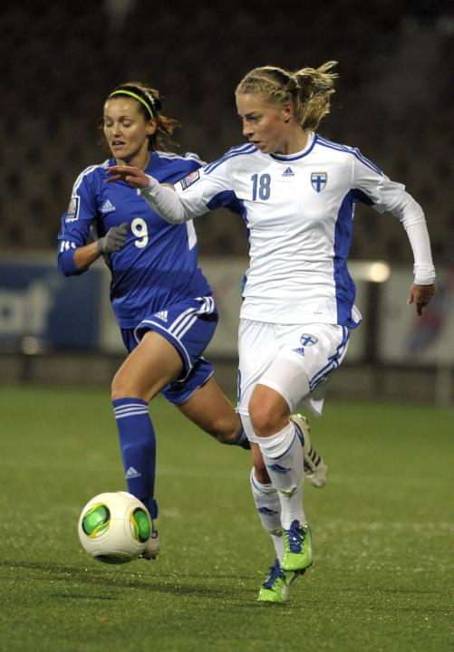 Kazakhstan's Krasyukova and Finland's Sallstrom fight for the ball during their women's 2015 World Cup qualifying soccer match in Helsinki