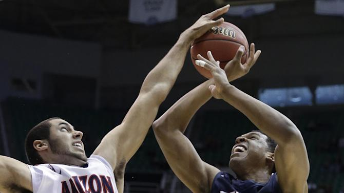 Arizona's Grant Jerrett (33) blocks a shot by Belmont's Blake Jenkins (2) during the first half in a second-round game in the NCAA college basketball tournament in Salt Lake City Thursday, March 21, 2013. (AP Photo/Rick Bowmer)