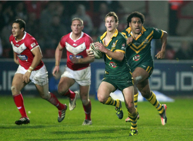 Australia's Daly Cherry-Evans, second right, makes a break against Wales during their four nations rugby league test match at the Racecourse Ground, Wrexham, Wales, Sunday Nov. 13, 2011. (AP Photo/Tim