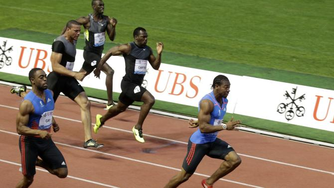 Yohan Blake, from Jamaica, right, wins ahead of Tyson Gay, from the US, left, during the men's 100-meter race, at the Athletissima Diamond League Athletics Meeting in Lausanne, Switzerland, Thursday, Aug. 23, 2012. (AP Photo/Keystone, Salvatore Di Nolfi)