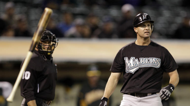 Florida Marlins' Gaby Sanchez, right, flings his bat after beingcalled out swinging by home plate umpire Phil Cuzzi, left, during the seventh inning of a baseball game against the Oakland Athletics Tuesday, June 28, 2011, in Oakland, Calif. Sanchez was then ejected by Cuzzi. (AP Photo/Ben Margot)