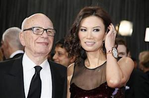 Rupert Murdoch, chairman and CEO of News Corporation, arrives with his wife Wendi Deng at the 85th Academy Awards in Hollywood, California