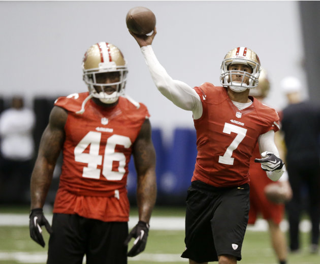 San Francisco 49ers quarterback Colin Kaepernick (7) passes as tight end Delanie Walker (46) waits to run a route during practice on Wednesday, Jan. 30, 2013, in New Orleans. The 49ers are scheduled t