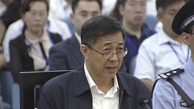 In this image taken from video, Former Chinese politician Bo Xilai speaks in a court room at Jinan Intermediate People's Court in Jinan, eastern China's Shandong province, Sunday, Aug. 25, 2013. Bo on Sunday sought to discredit his former top aide as a lying, unreliable witness as the ousted leader denied criminal responsibility in the country's messiest political scandal in decades.decades. (AP Photo/CCTV via AP Video) CHINA OUT, TV OUT