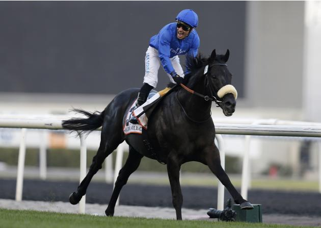 "De Sousa, riding Cavalryman of Britain, reacts as he races towards the finish line during the third race ""Dubai Gold Cup"" of the Dubai World Cup in Dubai"