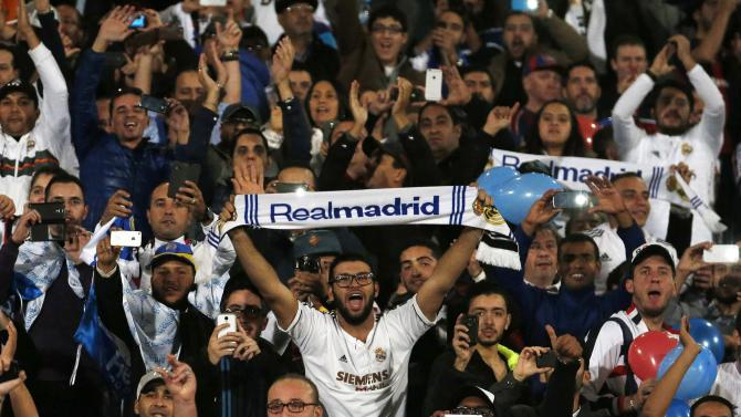 Fans of Real Madrid cheer before the start of their final soccer match against San Lorenzo in the Club World Cup at the Marrakech stadium