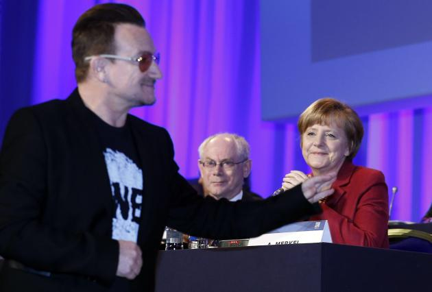 Photos of the day - March 7, 2014 Bono turns heads at the European People's Party (EPP) Elections Congress, Mamoru Samuragochi speaks during a press conference in Tokyo, Crufts dog show is underway in