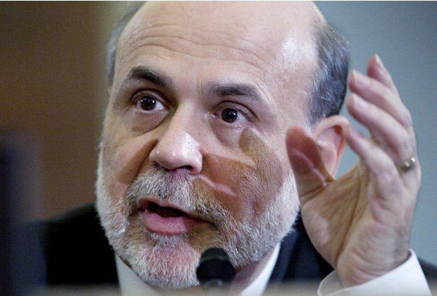FILE - In this Feb. 2, 2012 file photo, Federal Reserve Chairman Ben Bernanke testifies on Capitol Hill in Washington, before the House Budget Committee. Four times starting Tuesday, March 20, 2012, B