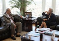 Christine Lagarde visits then Egyptian Finance Minister Samer Radwan at his office in Cairo in June last year. The IMF chief will visit Egypt next week, the IMF says, as discussions gear up over a possible $3.2 bn loan for the country