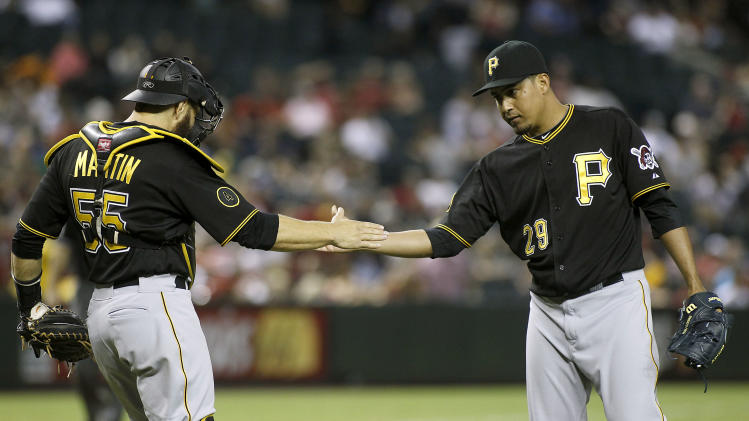 Pittsburgh Pirates catcher Russell Martin, left, congratulates Ernesto Frieri (29) after he pitches the ninth inning of a baseball game against the Arizona Diamondbacks, Friday, August 1, 2014, in Phoenix. The Pirates defeated the Diamondbacks 9-4. (AP Photo/ Ralph Freso)
