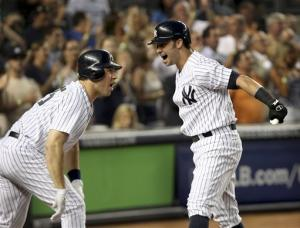 Swisher's slam helps Yankees beat Rangers