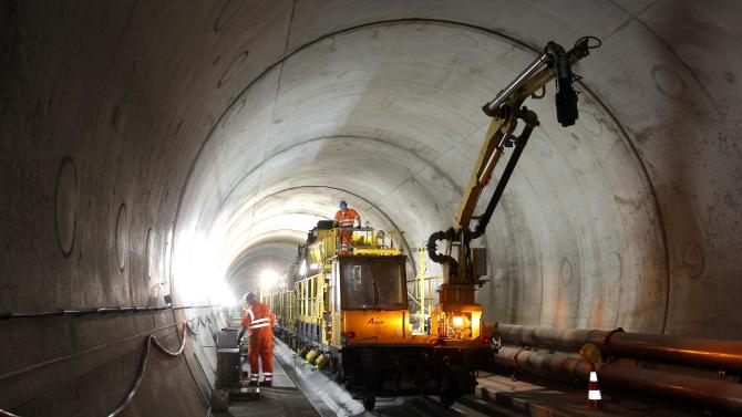 A worker stands on the special train 'Helvetia' in the NEAT Gotthard Base tunnel near Erstfeld