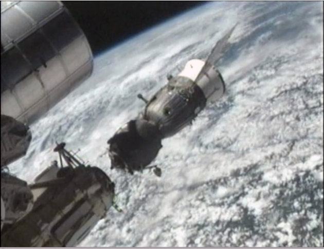 This image provided by NASA-TV shows the Soyuz TMA-03M space capsule carrying NASA astronaut Donald Pettit, Russia's Oleg Kononenko and Dutchman Andre Kuipers undocking from the International Space St