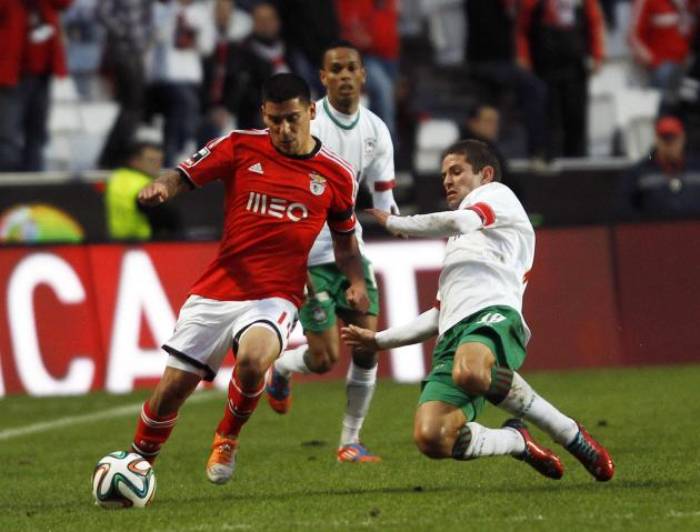 "Benfica's ""Maxi"" fights for the ball with Maritimo's Olim during their Portuguese Premier League match in Lisbon"