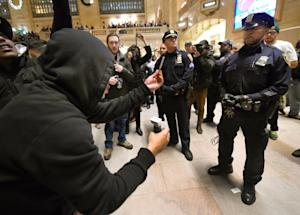 Police keep watch during a protest in Grand Central…