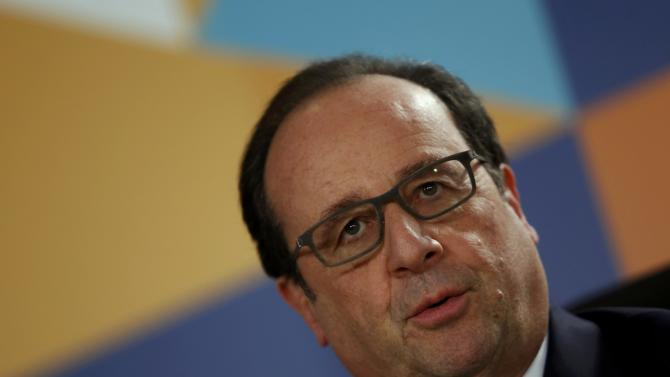 French President Hollande speaks during a news conference after the Climate Action Special Executive Session at  the Commonwealth Heads of Government Meeting (CHOGM) in Valletta