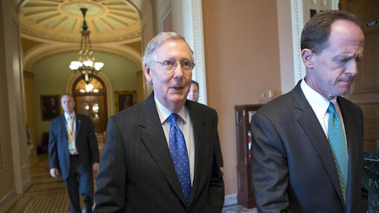 Senate Minority Leader Mitch McConnell, R-Ky., left, and Sen. Pat Toomey, R-Pa., walk to a closed door caucus as lawmakers moved toward resolving their feud over filibusters of White House appointees, at the Capitol in Washington, Tuesday, July 16, 2013. The Senate just voted 71-29 to end a two-year Republican blockade that was preventing Richard Cordray from winning confirmation as director of the Consumer Financial Protection Bureau. (AP Photo/J. Scott Applewhite)