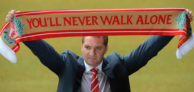 Newly Appointed Liverpool Football Club Manager Brendan Rodgers (C) Poses For Photographers With A Team Scarf To  AFP/Getty Images