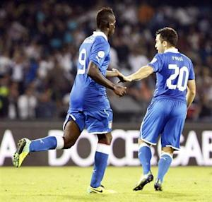 Italy's Balotelli celebrates with Rossi after scoring against Armenia during their 2014 World Cup qualifying soccer match in Naples