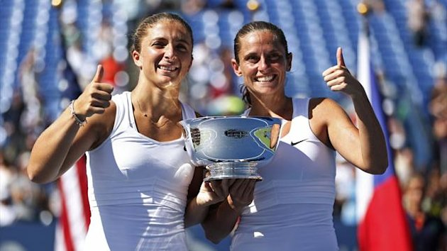 Sara Errani (L) and Roberta Vinci of Italy pose with their trophy after defeating Andrea Hlavackova and Lucie Hradecka of the Czech Republic in their women's doubles finals match at the U.S. Open tennis tournament in New York (Reuters)