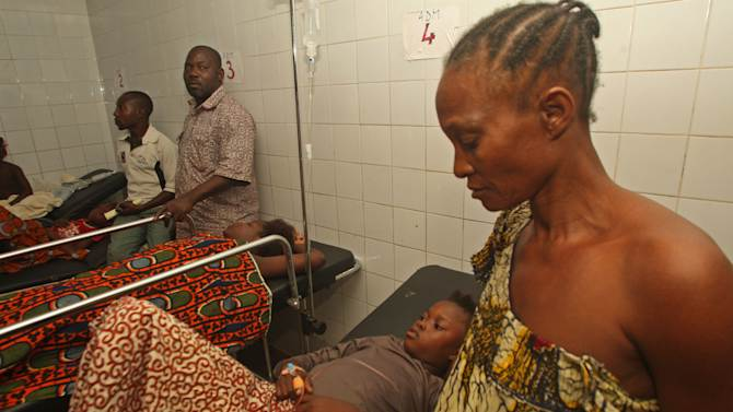 People injured in a stampede lie on hospital beds in Abidjan, Ivory Coast, Tuesday, Jan 1 2013. At least 61 people were killed early Tuesday in a stampede following a New Year's fireworks display in Abidjan, Ivory Coast's commercial center, said officials. The death toll is expected to rise, according to rescue workers. (AP Photo/Emanuel Ekra)