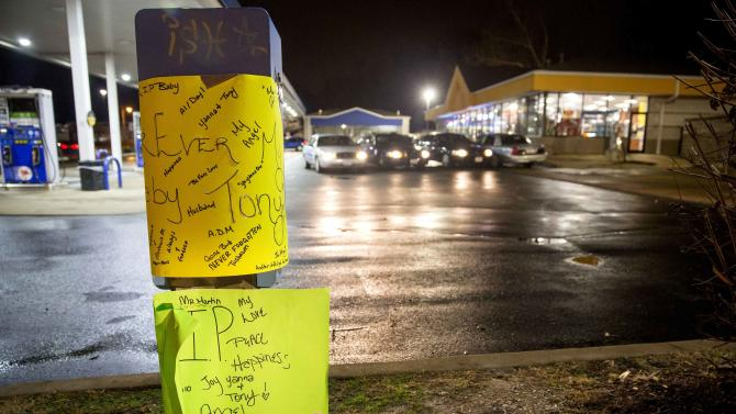 A memorial is set up at the scene where a policeman fatally shot a black man at a suburban gas station in Berkeley