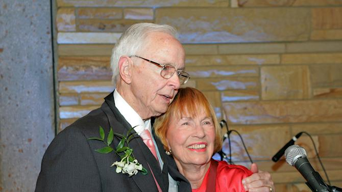 In a May 1, 2005 photo provided by the Country Music Hall of Fame, Jim Foglesong is honored at the Medallion Ceremony honoring him, in Nashville, Tenn. He is pictured with fellow Hall of Fame member Jo Walker-Meador. Foglesong, a music producer who helped launch Garth Brooks' career and was inducted into the Country Music Hall of Fame, died Tuesday, July 9, in Nashville, says a spokeswoman at Vanderbilt University's Blair School of Music, where Foglesong has been a faculty member since 1991. He was 90. (AP Photo/Country Music Hall of Fame and Museum, Donn Jones)