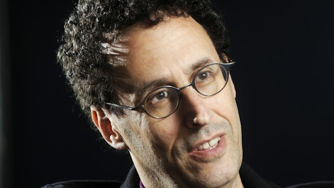 "FILE - In this April 30, 2009 photo, Tony Kushner is shown during a break from rehearsal of his new play at the Guthrie Theatre in Minneapolis, Minn.,  Kushner won a Pulitzer Prize for ""Angels in America,"" his epic play about the AIDS epidemic, and is a New York literary fixture who has received more than a dozen honorary degrees from American colleges and universities.  So it was a shock when the Board of Trustees of the City University of New York voted last month to withhold a promised honorary degree after a trustee said the playwright was anti-Israel. CUNY later backtracked under a barrage of criticism, and Kushner will accept his degree on Friday, June 2, 2011. (AP Photo/Craig Lassig)"