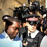 <p>UBS equities trader Kweku Adoboli (L) is led into a prison van in London in September 2011. The son of a Ghanaian former United Nations official, Adoboli worked for the global synthetic equities division at UBS in the City of London financial district. Adoboli was arrested in London on September 15 last year on suspicion of the fraud.</p>