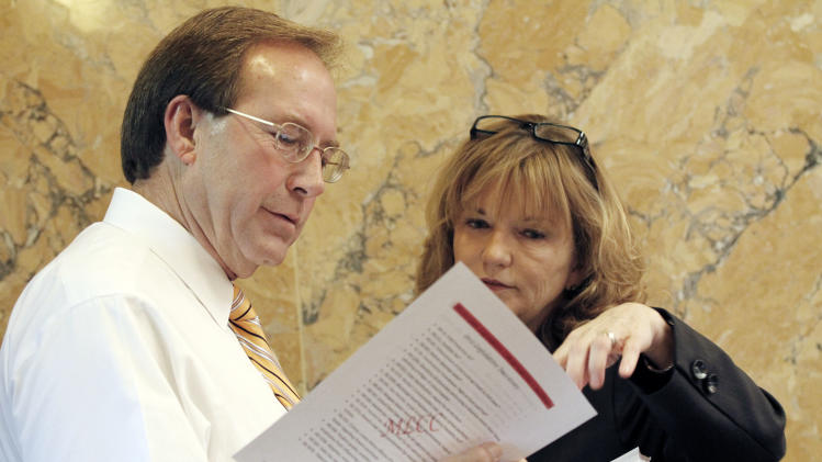 Immigration reform advocate Rep. Becky Currie, R-Brookhaven, right confers with House Education Committee chairman John Moore, R-Brandon at the Capitol in Jackson, Miss., Thursday, April 26, 2012.   Currie is a staunch proponent for stronger immigration laws. (AP Photo/Rogelio V. Solis)