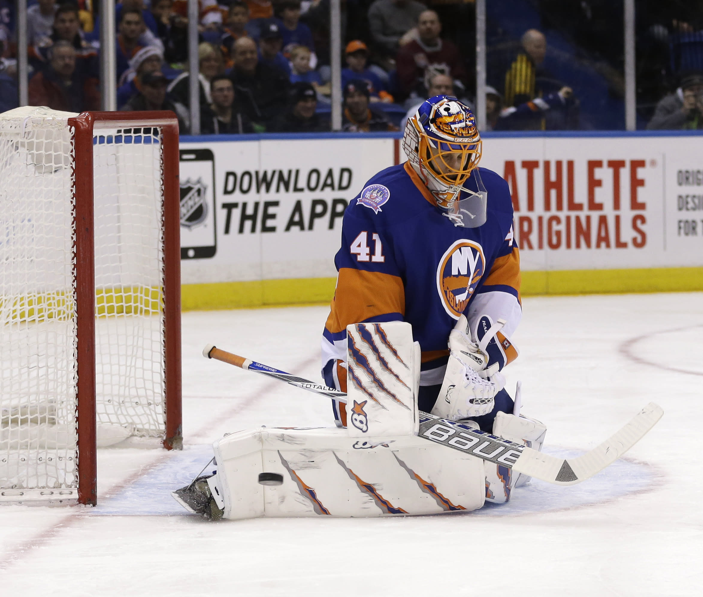 Halak tops Flames to set Islanders' single-season win record