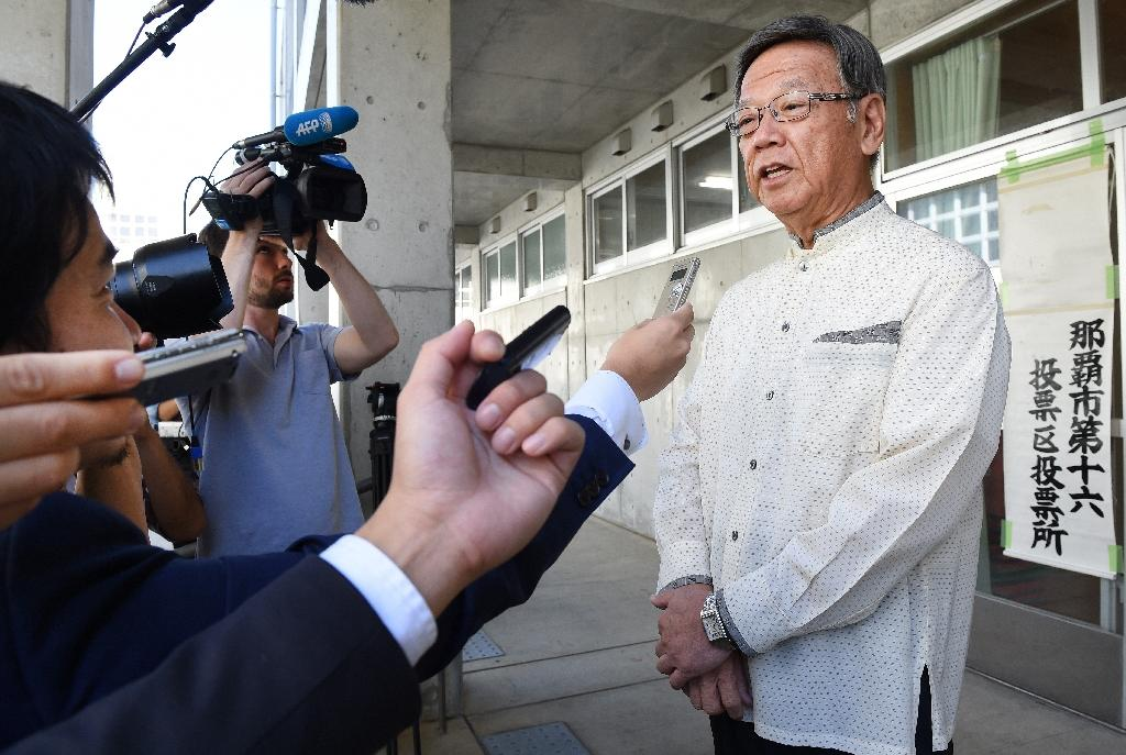 Japan minister sidesteps Okinawa governor in base row