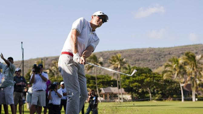 Scott Langley follows his shot off the 13th fairway during the final round of the Sony Open golf tournament, Sunday, Jan. 13, 2013, in Honolulu. (AP Photo/Marco Garcia)
