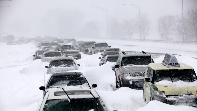FILE - In this Feb. 2, 2011 file photo, hundreds of cars are seen stranded on Lake Shore Drive in Chicago after a winter blizzard of historic proportions wobbled an otherwise snow-tough Chicago. America's wild weather year has hit yet another new high: a devastating dozen billion-dollar catastrophes. The National Oceanic and Atmospheric Administration announced Wednesday that it has recalculated the number of weather disasters passing the billion dollar mark, with two new ones, pushing 2011's total to 12. The two costly additions are the Texas, New Mexico and Arizona wildfires and the mid June tornadoes and severe weather.  (AP Photo/Kiichiro Sato, File)