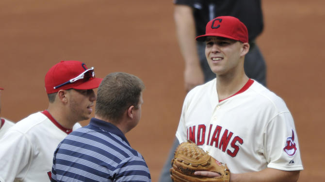 Cleveland Indians starting pitcher Justin Masterson, right, reacts while being taken from the game with an apparent injury in the second inning against the Baltimore Orioles during a baseball game, Monday, Sept. 2, 2013, in Cleveland. (AP Photo/David Richard)