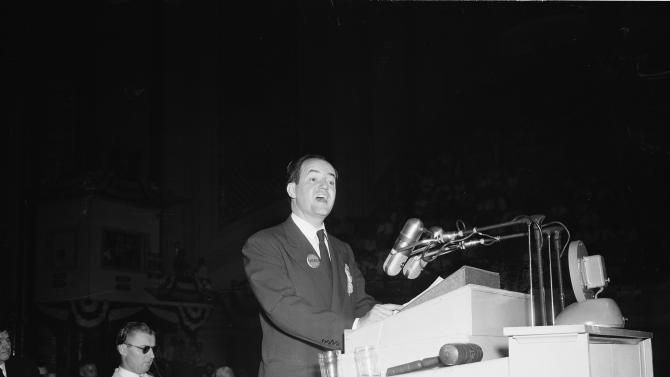 """FILE - In this July 14, 1948, file photo, Mayor Hubert H. Humphrey of Minneapolis wears a Truman button as he addresses the Democratic National Convention at Philadelphia. Democrats have little hope of matching the fervor and historical import of their 2008 convention, when they made Barack Obama the first black presidential nominee of a major political party. One of the memorable moments from past conventions was Humphrey declaring it's time to """"get out of the shadow of states' rights and walk forthrightly into the bright sunshine of human rights."""" When support for civil rights is added to the party platform, Mississippi's delegates and half of Alabama's walk out. (AP Photo/File)"""