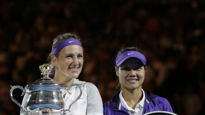 Victoria Azarenka, left, of Belarus holds her trophy after winning the women's final against China's Li Na, right, at the Australian Open tennis championship in Melbourne, Australia, Saturday, Jan. 26, 2013. (AP Photo/Andy Wong)