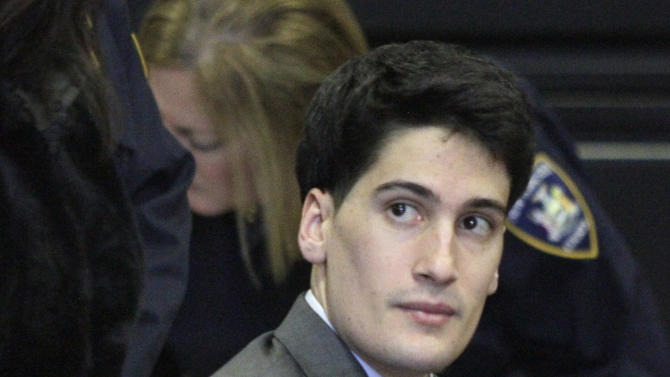 FILE - In this Friday, Feb. 17, 2012 file photo, Renato Seabra, a Portuguese model charged with castrating and killing Portuguese TV personality Carlos Castro in a New York hotel, listens while seated handcuffed at his court hearing in New York. Seabra was convicted last month of choking, bludgeoning and mutilating Castro and was sentenced Friday, Dec. 21, 2012, to 25 years to life in prison.  (AP Photo/Bebeto Matthews, File)