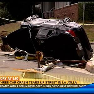 Wild three-car crash tears up street in La Jolla