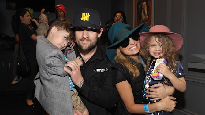 Joel Madden, 2nd left, Nicole Richie, 2nd right, and their children Sparrow Madden, left, and Harlow Madden, right, attend Yo Gabba Gabba! Live!: Get The Sillies Out! 50+ city tour kick-off performance on Thanksgiving weekend at Nokia Theatre L.A. Live on Friday Nov. 23, 2012 in Los Angeles. (Photo by John Shearer/Invision for GabbaCaDabra, LLC./AP Images)