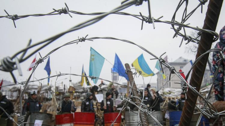 A barricade is seen at the Independence Square where pro-European integration supporters are holding a rally in Kiev