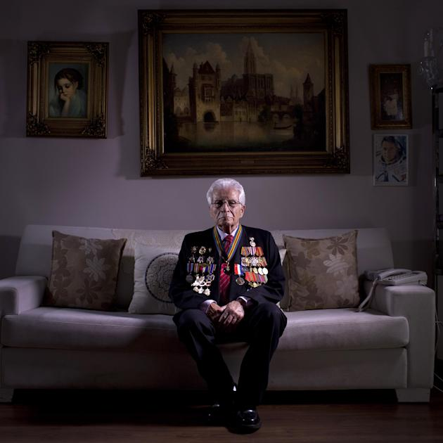 In this photo made Wednesday, April 10, 2013, Soviet Jewish World War Two veteran Shalom Skopes, 88, poses for a portrait at his house in Tel Aviv Israel.  Skopes was a battalion commander in the Red